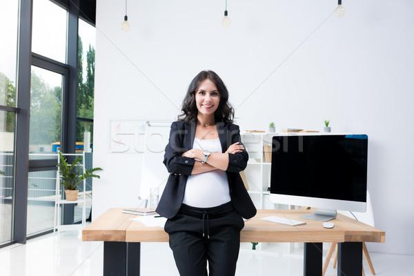 pregnant businesswoman with crossed arms Stock photo © LightFieldStudios