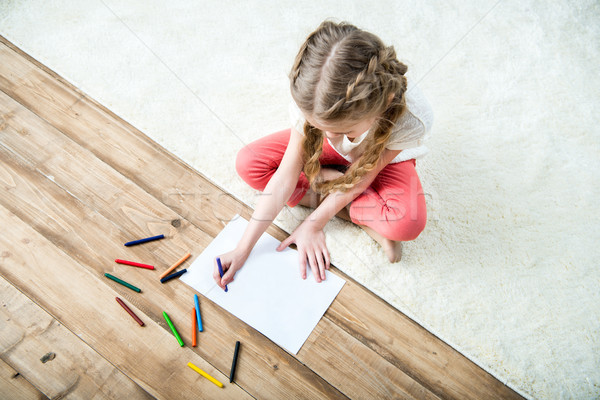 high angle view of little girl drawing picture Stock photo © LightFieldStudios