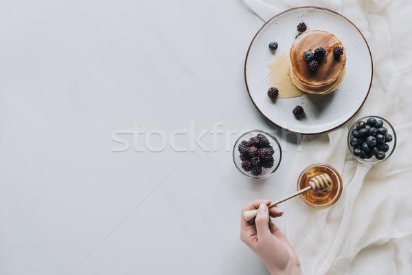Felső kilátás személy eszik friss házi készítésű Stock fotó © LightFieldStudios