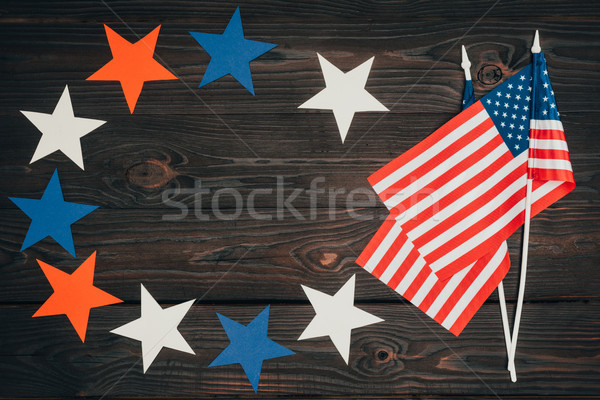 top view of arranged american flags and stars on wooden surface, presidents day celebration concept Stock photo © LightFieldStudios
