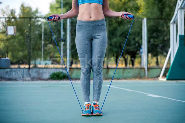Woman exercising with jump rope Stock photo © LightFieldStudios