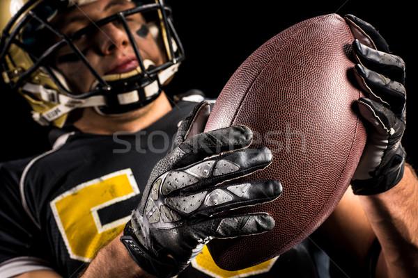 Amerikai futballista tart labda alulról fotózva kilátás Stock fotó © LightFieldStudios