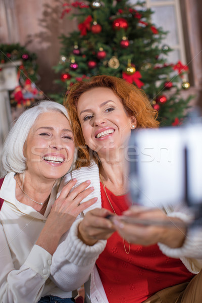 Two women taking selfie  Stock photo © LightFieldStudios