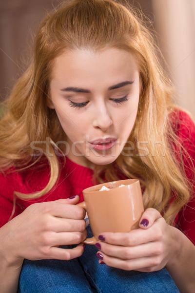 Lány iszik forró csokoládé szőke nő nő haj Stock fotó © LightFieldStudios