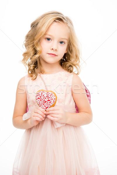Girl holding heart shaped cookie    Stock photo © LightFieldStudios