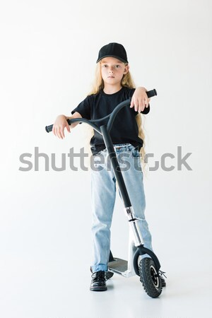 Mulher aspirador de pó mulher jovem em pé olhando câmera Foto stock © LightFieldStudios