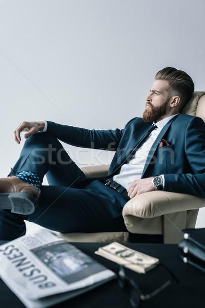 Vista lateral pensativo empresario sesión sillón oficina Foto stock © LightFieldStudios