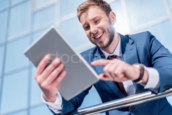 Stock photo: businessman using digital tablet