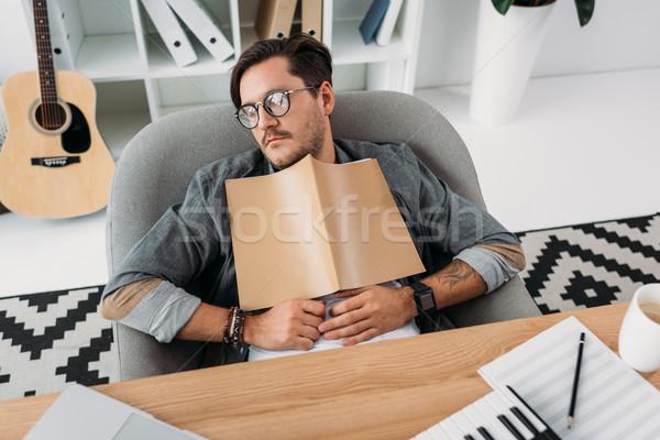 исчерпанный музыканта спальный молодые журнала клавиатура Сток-фото © LightFieldStudios