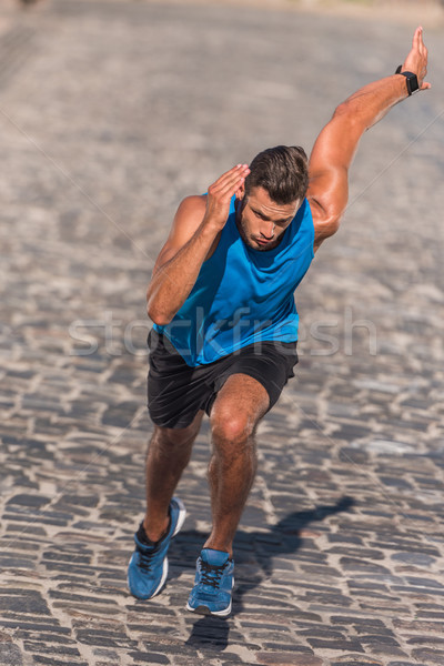 sportsman running in city Stock photo © LightFieldStudios