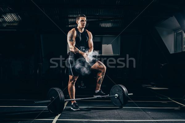 sportsman applying talcum to hands Stock photo © LightFieldStudios