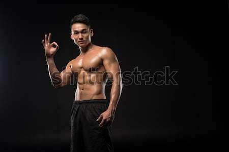 sportsman showing ok sign Stock photo © LightFieldStudios