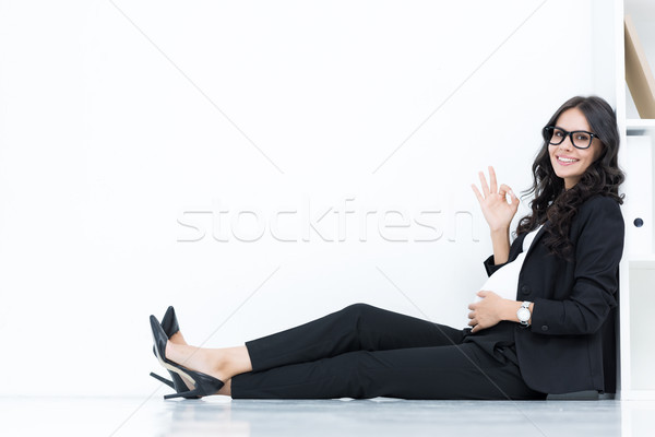 pregnant businesswoman showing okay sign Stock photo © LightFieldStudios