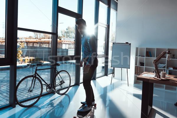 businessman on skateboard in office Stock photo © LightFieldStudios