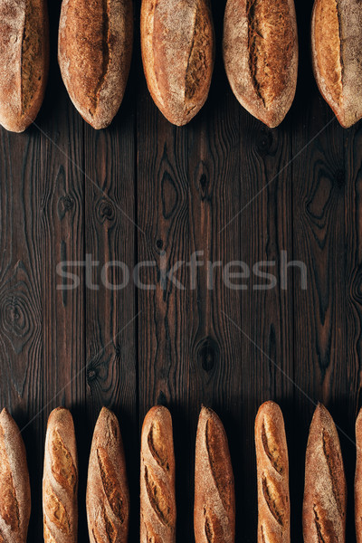 Top brood frans baguettes houten Stockfoto © LightFieldStudios