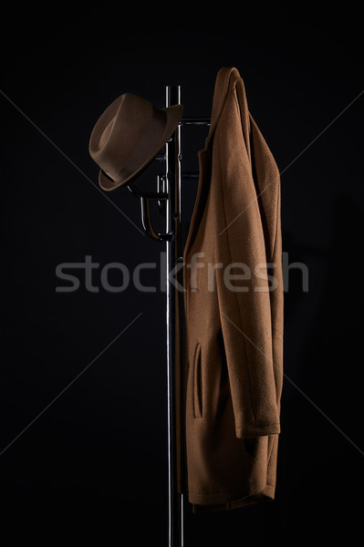 Chapeau classique veste suspendu manteau rack Photo stock © LightFieldStudios
