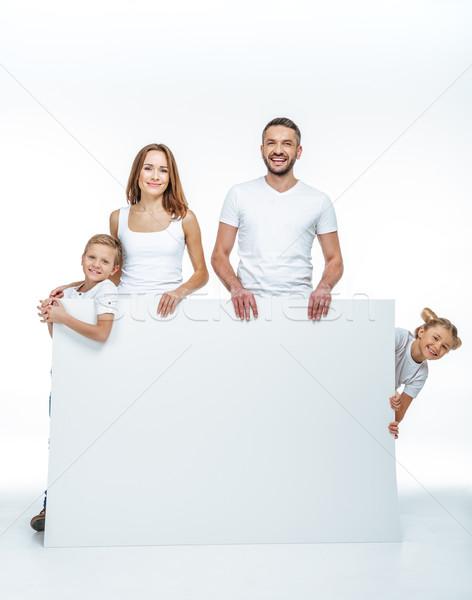 Mutlu aile boş kart beyaz bakıyor kamera Stok fotoğraf © LightFieldStudios