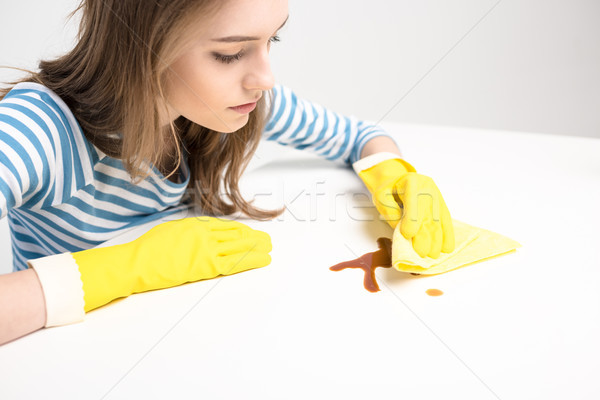 Woman removing stain Stock photo © LightFieldStudios