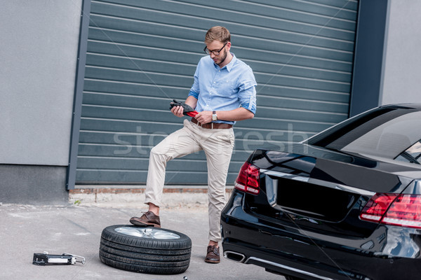 man changing car tire  Stock photo © LightFieldStudios