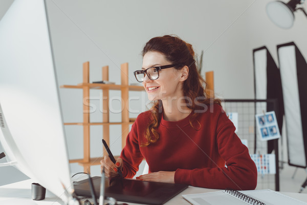 designer working with graphics tablet Stock photo © LightFieldStudios