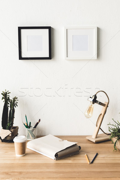 Stock photo: photo frames hanging on wall in room