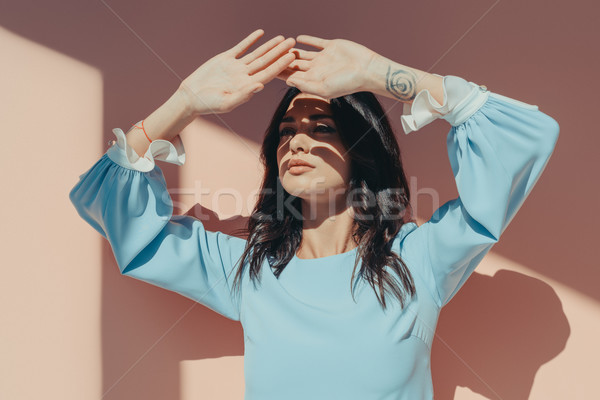Pensive woman with hands against eyes Stock photo © LightFieldStudios