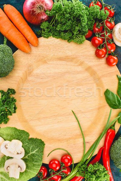 Stock photo: top view of fresh healthy raw vegetables and empty wooden plate