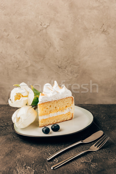 delicious piece of cake with whipped cream, fresh blueberries and tulips on plate Stock photo © LightFieldStudios
