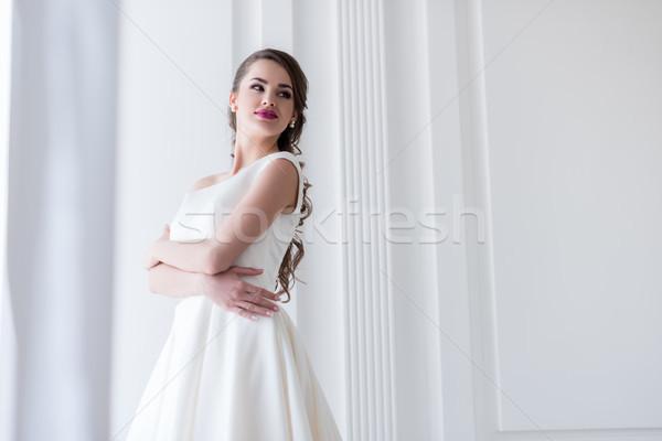Schönen Brünette Braut posiert Hochzeitskleid Hochzeit Stock foto © LightFieldStudios