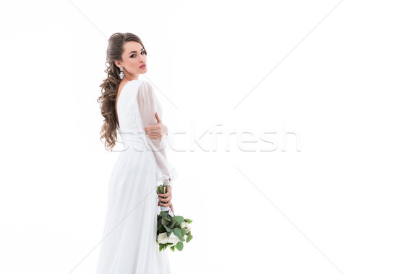 attractive young bride posing in white dress with wedding bouquet, isolated on white Stock photo © LightFieldStudios