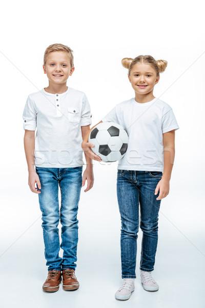 笑みを浮かべて 子供 立って サッカーボール 2 見える ストックフォト © LightFieldStudios