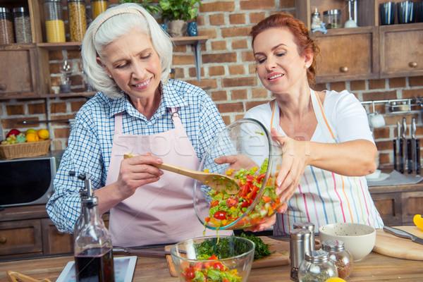 Women cooking together Stock photo © LightFieldStudios