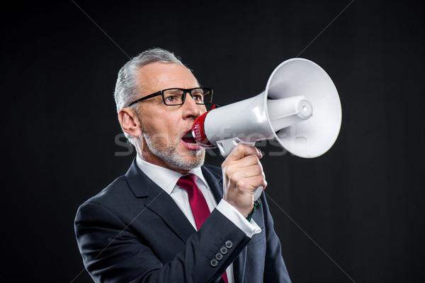 Maturité affaires haut-parleur lunettes parler noir Photo stock © LightFieldStudios