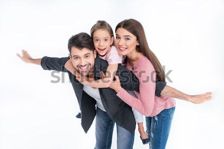 Happy young family with one child having fun together on white Stock photo © LightFieldStudios