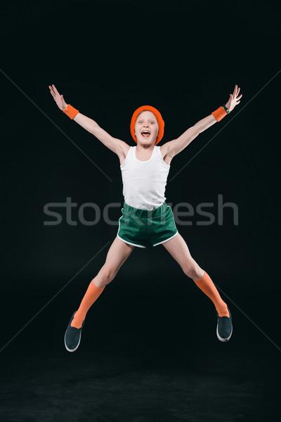 Odzież sportowa skoki patrząc kamery odizolowany Zdjęcia stock © LightFieldStudios