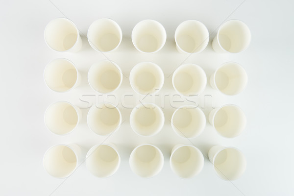 Close-up top view of empty plastic cups isolated on grey Stock photo © LightFieldStudios