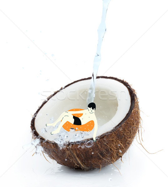 drawn man on float in tropical coconut half  Stock photo © LightFieldStudios