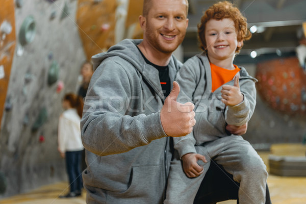 dad with son showing thumbs up Stock photo © LightFieldStudios