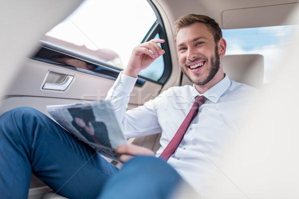Férfi újság boldog fiatalember üzletember igazgató Stock fotó © LightFieldStudios