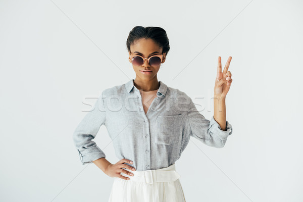 african american woman showing peace sign Stock photo © LightFieldStudios