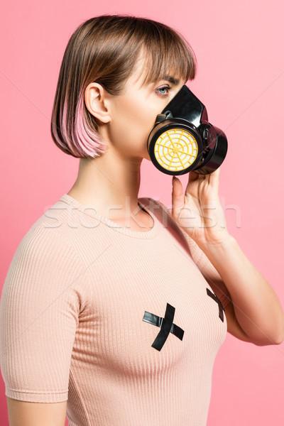 Fashionable woman with respirator Stock photo © LightFieldStudios