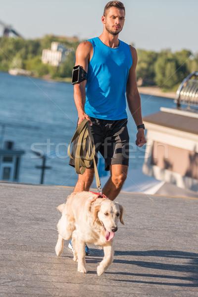 sportsman walking with dog Stock photo © LightFieldStudios