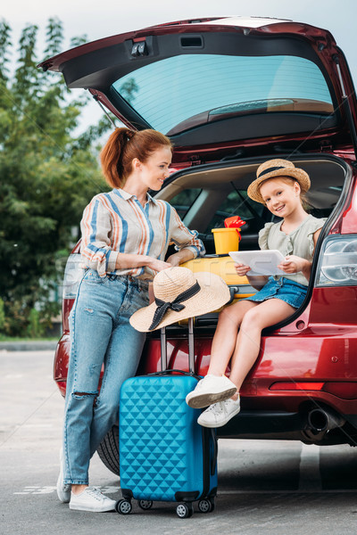 mother and daughter in car trunk Stock photo © LightFieldStudios