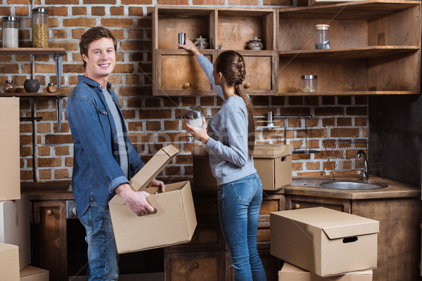 couple unpacking cardboard box Stock photo © LightFieldStudios