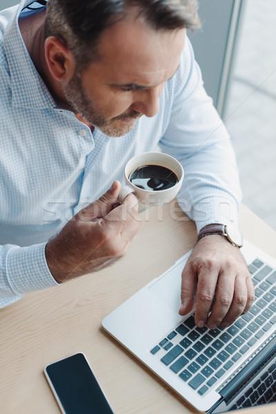 businessman working with laptop Stock photo © LightFieldStudios