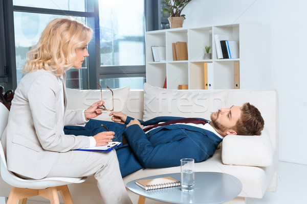 psychologist and patient at therapy Stock photo © LightFieldStudios