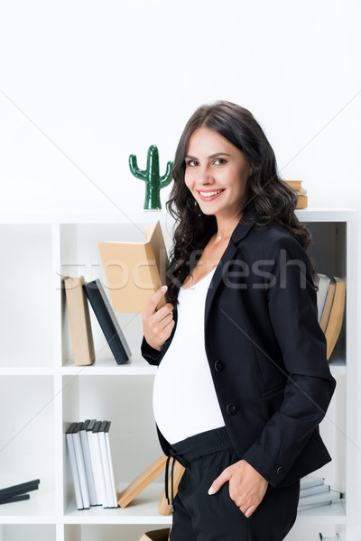 Stock photo: pregnant businesswoman with book