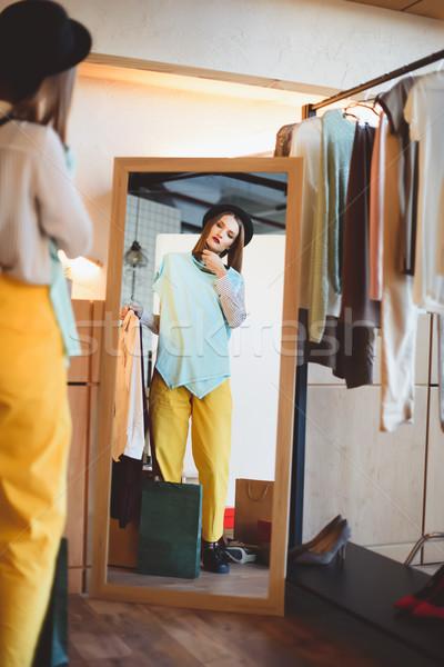 fashionable girl choosing clothes  Stock photo © LightFieldStudios