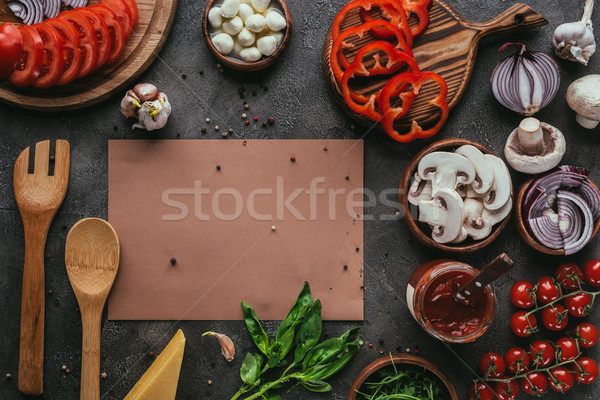top view of pizza ingredients and blank paper on concrete table Stock photo © LightFieldStudios