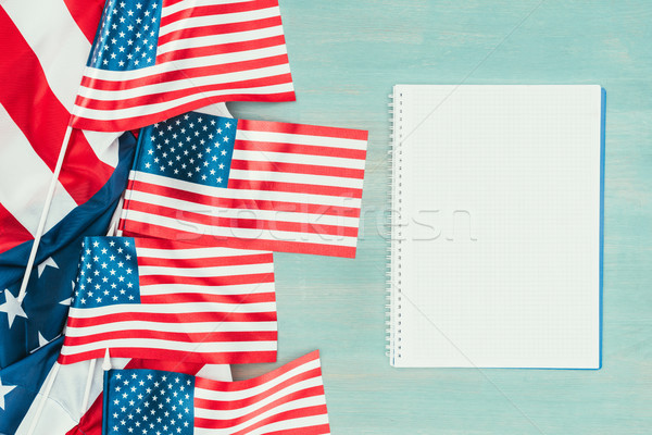 top view of arranged american flags and blank notebook on blue wooden tabletop, presidents day conce Stock photo © LightFieldStudios